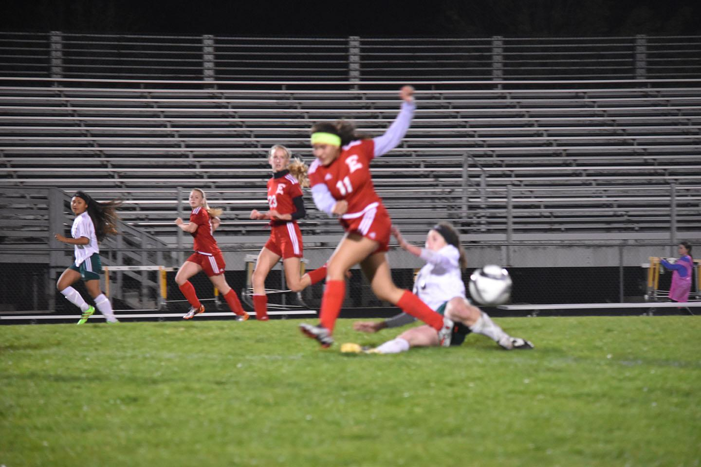 "Girls varsity soccer player Wendy Murillo jumps over rival opponent as the soccer players are fighting to get control of the ball. ""Girls are as competitive as boys,"" soccer parent Kristina Garcia said."